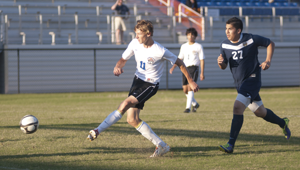 Adam Brooker takes a shot on goal in Wednesday's game against Bryant High School. He scored two goals in the game.