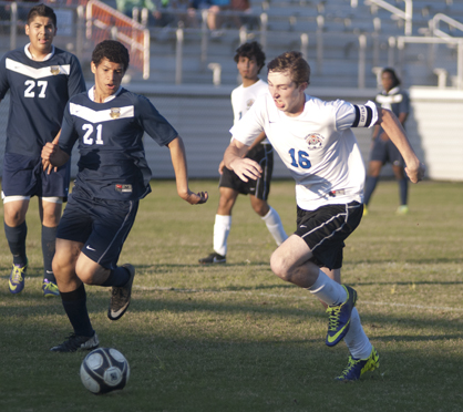 Austin Brooks attacks the Bryant defense. He scored one goal in the 6-1 win over Bryant.