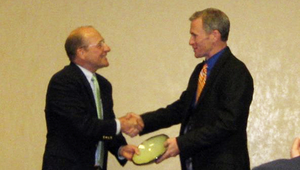 Trey McDonald (right) receives the Spirit of Sustainability Award from Mike Kensler, director of AU's Office of Sustainability.