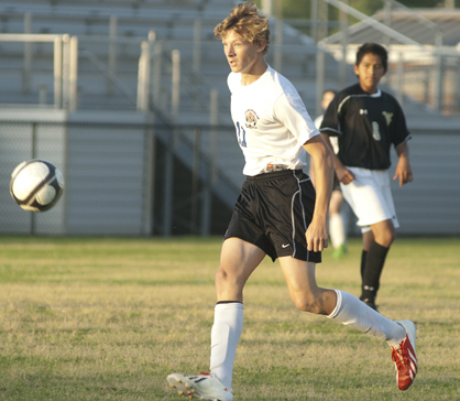 Adam Brooker looks the ball in to attack the Walker defense.