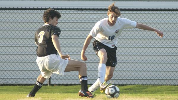 Demopolis' Austin Brooks makes a move to get around his defender.