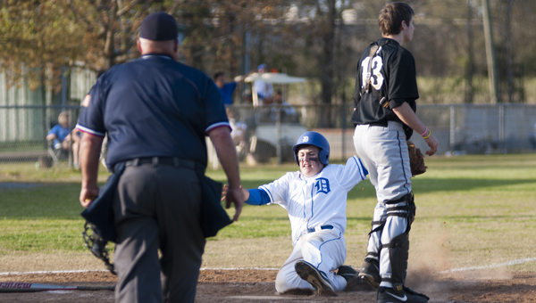 R.J. Cox slides into home for a run in Demopolis' 6-4 win over Greenville on Tuesday.