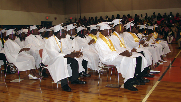 Linden High School graduates look on during speeches given at the graduation ceremony Friday night.