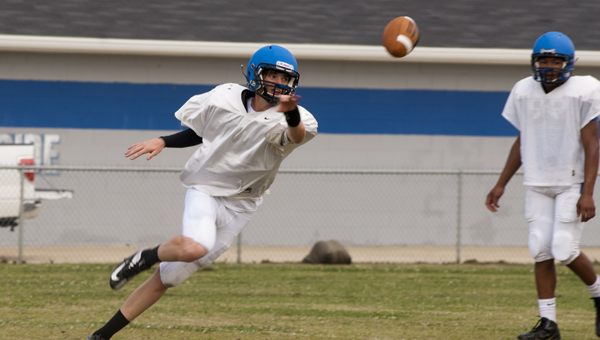Tripp Perry, who is competing for the starting job in the fall, makes a pitch during spring practice.