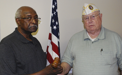 John E. Doby (left) is handed the gavel of authority from past Marengo County Disabled American Veterans Chapter Commander Ray Morrison. Doby was elected to the position in April and will serve for the 2014-15 term.