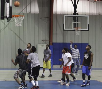 Robert Clayton, Cedric Cook, Wesley Harris, Jamar Collier, Lakendrick Jones, Antoine Collier and Otis Cistrunk play basketball at the Theo Ratliff Activity Center.