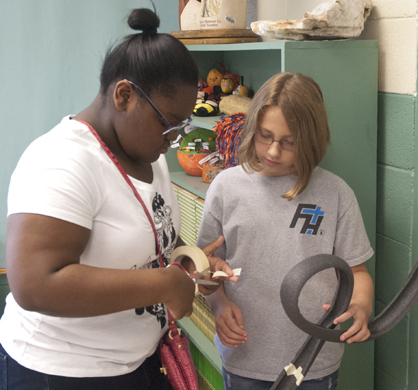 Mia Daniels (left) and Alyssa Dial work on their roller coaster.