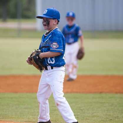 Cameron Bell shouts encouragement for his teammates on defense during the 8U game against Sweet Water.