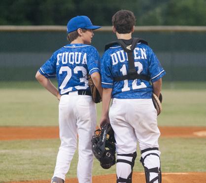 Demopolis 12U pitcher Andrew Fuqua and catcher Hunter Duren discuss strategy before the game.