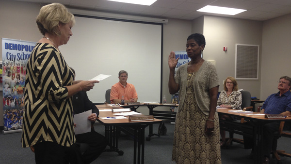 Carolyn Moore (right) is sworn in to the Demopolis Board of Education by Gina Johnston.