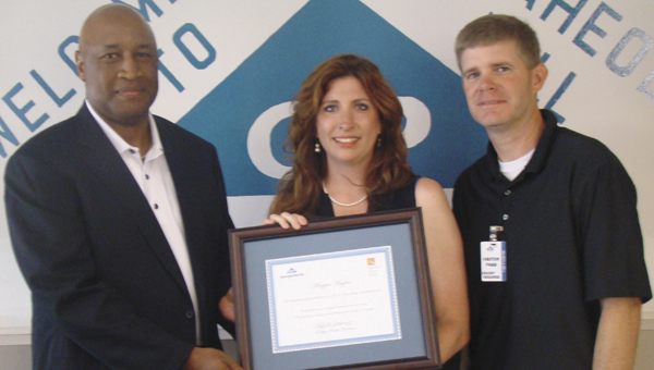 Shown from left to right are Kelvin J. Hill, vice president of Georgia-Pacific's Naheola operations; Meggin Mayben, 2014 Keystone Teacher's Development Winner; and Blaine Hathcock, principal of Demopolis Middle School.