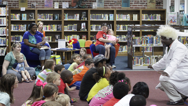 """""""The Professor"""" Patrick George shows children at The Demopolis Public Library how to create the sound of rain and thunder with claps and stomps."""