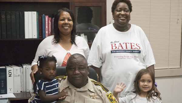 """Marengo County Sheriff Richard """"Ben"""" Bates, shown with his wife, Carolyn Bates; granddaughter, Zoe Love; and friends, Tamika Dial and Mercy Palmer, won Tuesday's runoff to remain Sheriff for another term."""