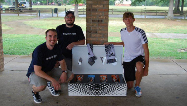 Patrick McLandon and Craig Justice from Soccer.com present Adam Brooker with the #allin or nothing Battle Pack Photo Contest Grand Prize.