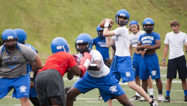 Demopolis quarterback Tripp Perry looks for an open receiver in the Tigers' 11-on-11 practice with Neshoba Central High School (Miss.) at UWA on Thursday.