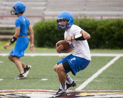 Demopolis quarterback Logan McVay tries to find an open hole to run through.