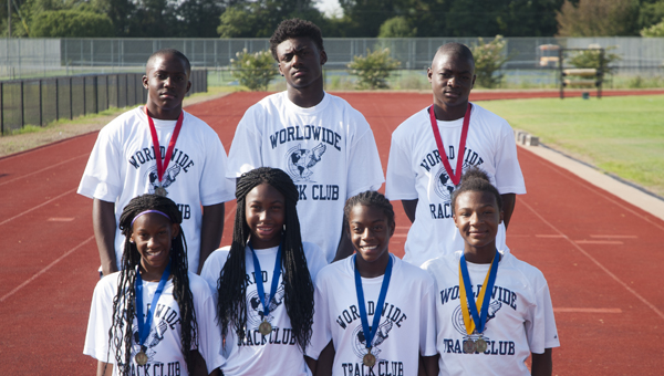 Eight members of the Worldwide Track Club that will travel to Humble, Texas, for the USA Track and Field National Junior Olympic Track and Field Championships on July 21-27. Shown are Antonio Besteder, Anthony Jackson, Alexander Besteder, Ny'Keria Grayer, Ashleigh Ivory, Yasmein Rainey and Shy'shawna Smith. Not pictured is Joseph Merriweather.