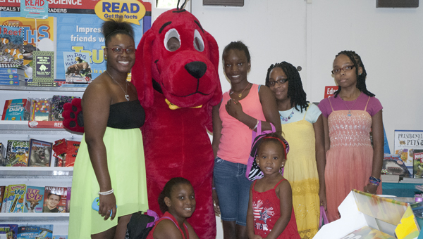 Shown at the Demopolis Public Library Scholastic Book Fair with Clifford the Big Red Dog are JaMari Williams, Amarriah Knott, Simcha Prater, Jamealeyah Williams, Yafita Prater and Jasmine Williams.