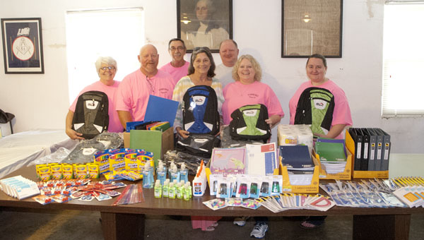 The Tombigbee Chapter No. 51 of the Order of the Eastern Star donated school supplies to Harriet's House. Shown are Pat Singleton, Worthy Patron Rusty Byars, Don Singleton, Susanna Naisbett, Bill Noland, Worthy Matron Lisa Noland and Janet Byars.