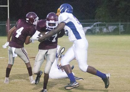 Warren Boykin tries to shake off a tackler.