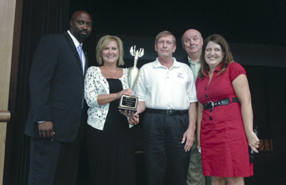 Westside Elementary won this year's trophy for raising the most money during SchoolFest. Shown are Westside principal Tony Pittman, Westside SchoolFest Chairwoman Terri Cameron, DCSF Vice President Kim Townsend, Northcutt and Barnes.