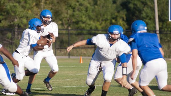 Demopolis junior running back Jayjerrin Craig takes a handoff from senior quarterback Tripp Perry in Thursday's scrimmage.