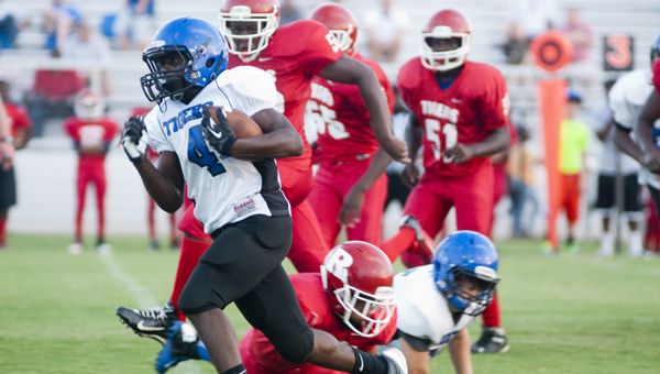 Antonio Besteder breaks a run to the outside for Demopolis Middle School against Riverside-Collins Middle School.