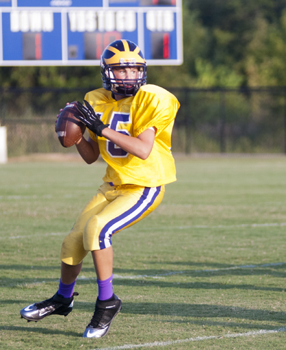 Sweet Water quarterback John Thomas Etheridge drops back to pass against Echols Middle School.