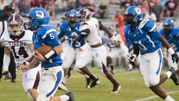 Demopolis quarterback Logan McVay scrambles for yards against Thomasville.