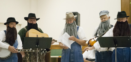 Members of the Soggy Bottom Boys sing during Thursday morning's Joy Day.
