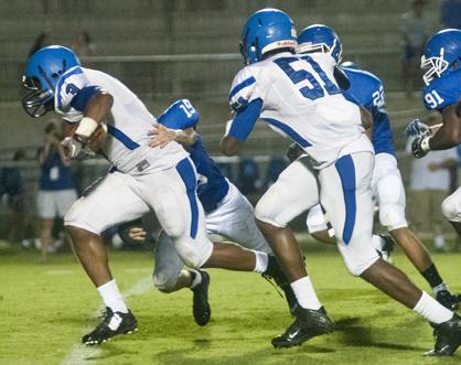 Rashad Lynch breaks a tackle on his way to a 30-yard touchdown run.