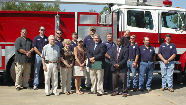 : The Alabama Forestry Commission donated a ladder truck to the Pine Hill Volunteer Fire Department to help them better serve their community. Shown are (front row), Harold Swearingen, Pine Hill Town Council member; Mayor Roberta Jordan, Town of Pine Hill; Jan Agee, Pine Hill Town Council member; Greg Pate, Alabama's State Forester; and Oscar Berry III, on behalf of U.S. Congresswoman Terri Sewell; (back row), volunteer firefighters with the Pine Hill VFD.