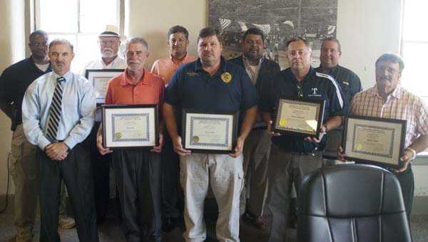 The 17th Judicial Circuit Drug Task Force and District Attorney Greg Griggers recognized individuals and businesses that have supported the task force since it started in 2011. Shown are York Police Department Chief Brian Harris, Griggers, Dr. Bobby Williams, Roger Willis with RockTenn, Jay Reynolds, Linden PD Chief Scott McClure, J.R. Rivas, Thomaston Mayor Jeff Laduron, Kevin McKinstry with Westervelt and Ronnie O'Neal. Not pictured are