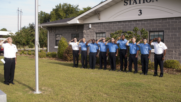 The Demopolis Fire Department salutes the American flag during a 9/11 remembrance ceremony Thursday morning.