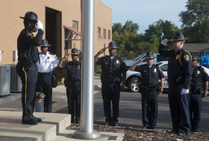 DPD Honor Guard members Don Johnson and Cody Key present arms during a 9/11 ceremony at the police station Thursday morning.