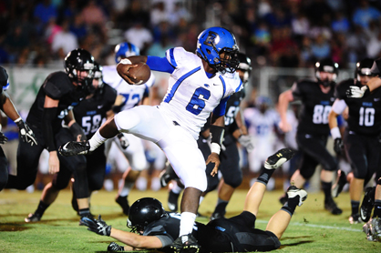 Jayjerein Craig breaks through Helena tacklers during the Tigers' win Friday night.