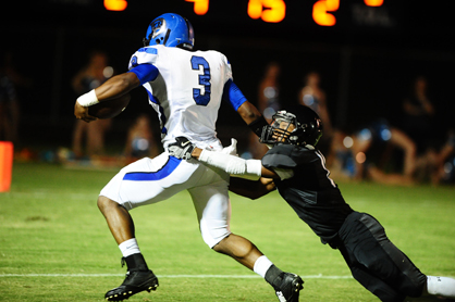 Demopolis' Rashad Lynch runs past Helena tacklers. He finished the game with 131 yards and three touchdowns on nine carries.