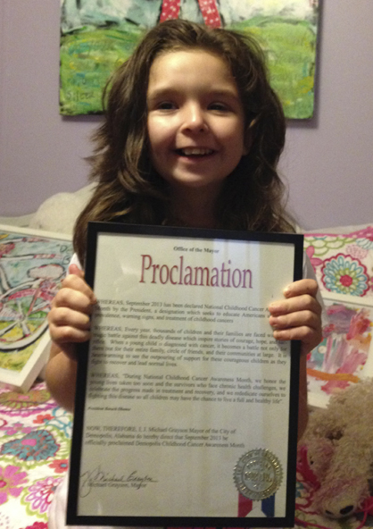 Anna-Coleman Yelverton is shown with Demopolis' Childhood Cancer Awareness proclamation.