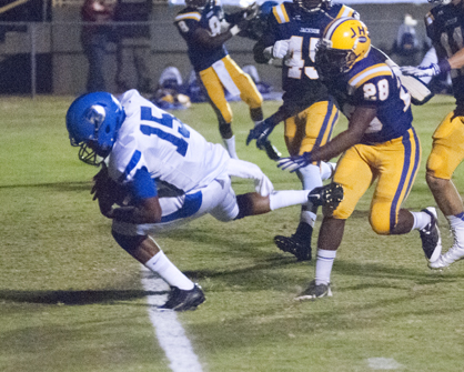 Demopolis quarterback Jamarcus Ezell crosses the goal line for a score. He led the Tigers with 217 rushing yards and two touchdowns.