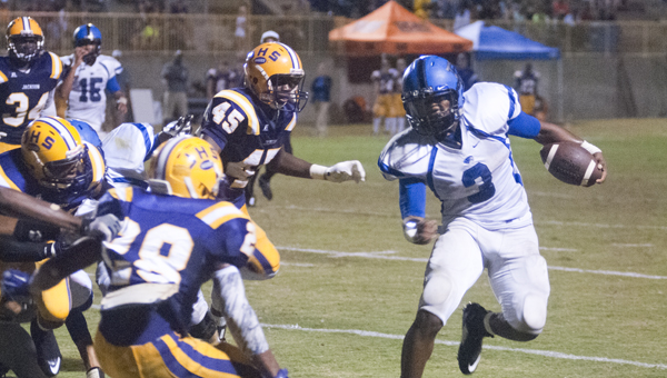 Demopolis running back Rashad Lynch jukes a Jackson defender. He finished the game with 102 yards and two touchdowns on 19 carries.