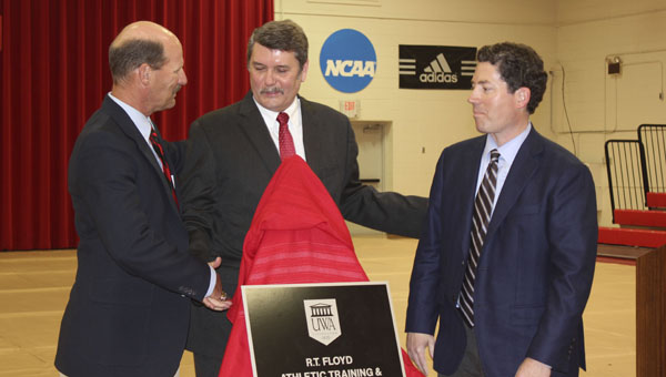 UWA dedicated the R.T. Floyd Athletic Training and Sports Medicine Center on campus with a ceremony and tour of the new facility. The facility's namesake, Dr. R.T. Floyd, center, is congratulated by Brad Montgomery, head athletic trainer for UWA, at left, and Dr. E. Lyle Cain, orthopedic surgeon for Andrews Sports Medicine & Orthopaedic Center of Birmingham, at right.