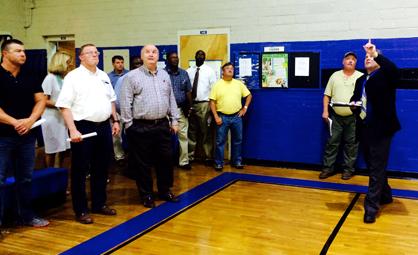 Demopolis City Schools Superintendent Al Griffin shows improvements at Demopolis Middle School's gym.