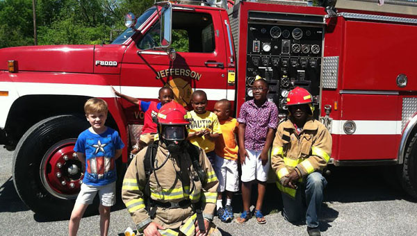 The Jefferson Volunteer Fire Department will host its annual barbecue Saturday, Oct. 4 at the Jefferson Country Store. Shown above, Jefferson firefighters Dave Compton (left) and Bobby Lynch (right) participated in AME Zion Church's Youth Day earlier this summer to discuss fire safety and prevention.