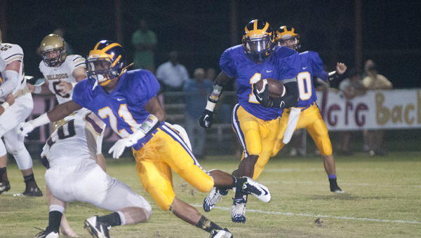 Sweet Water's Keldric Greene breaks a run to the outside. He led Sweet Water with 70 yards rushing on 14 carries in Thursday night's loss.