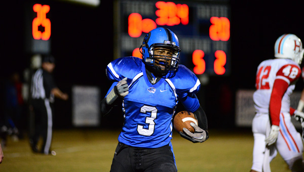 Demopolis High School senior running back Rashad Lynch celebrates the first of his three touchdowns in the Tigers' 39-29 loss to Hillcrest-Tuscaloosa Thursday night. (Times Staff/Andy Brown)