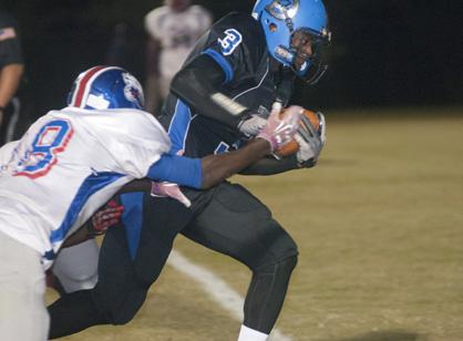 Rashad Lynch breaks through a Wilcox Central tackler.