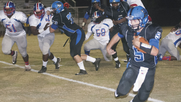Demopolis quarterback Logan McVay makes a move on a defender on his 65-yard touchdown run in the second quarter Friday night against Wilcox Central.