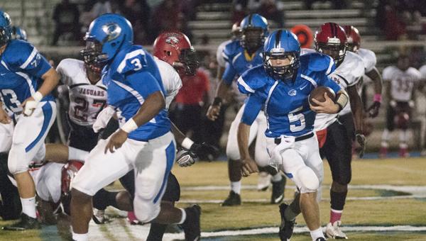 Demopolis quarterback Logan McVay follows his blockers on a run Friday night against Sumter Central.