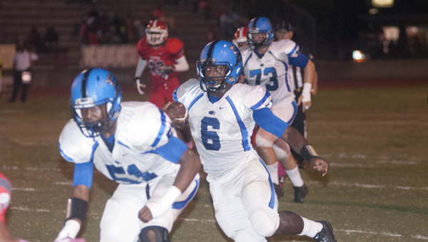 Jayjerein Craig follows his blockers on his way to a 36-yard touchdown reception as time expired in the first half.