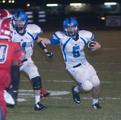 Demopolis quarterback Logan McVay finds a hole to run through.